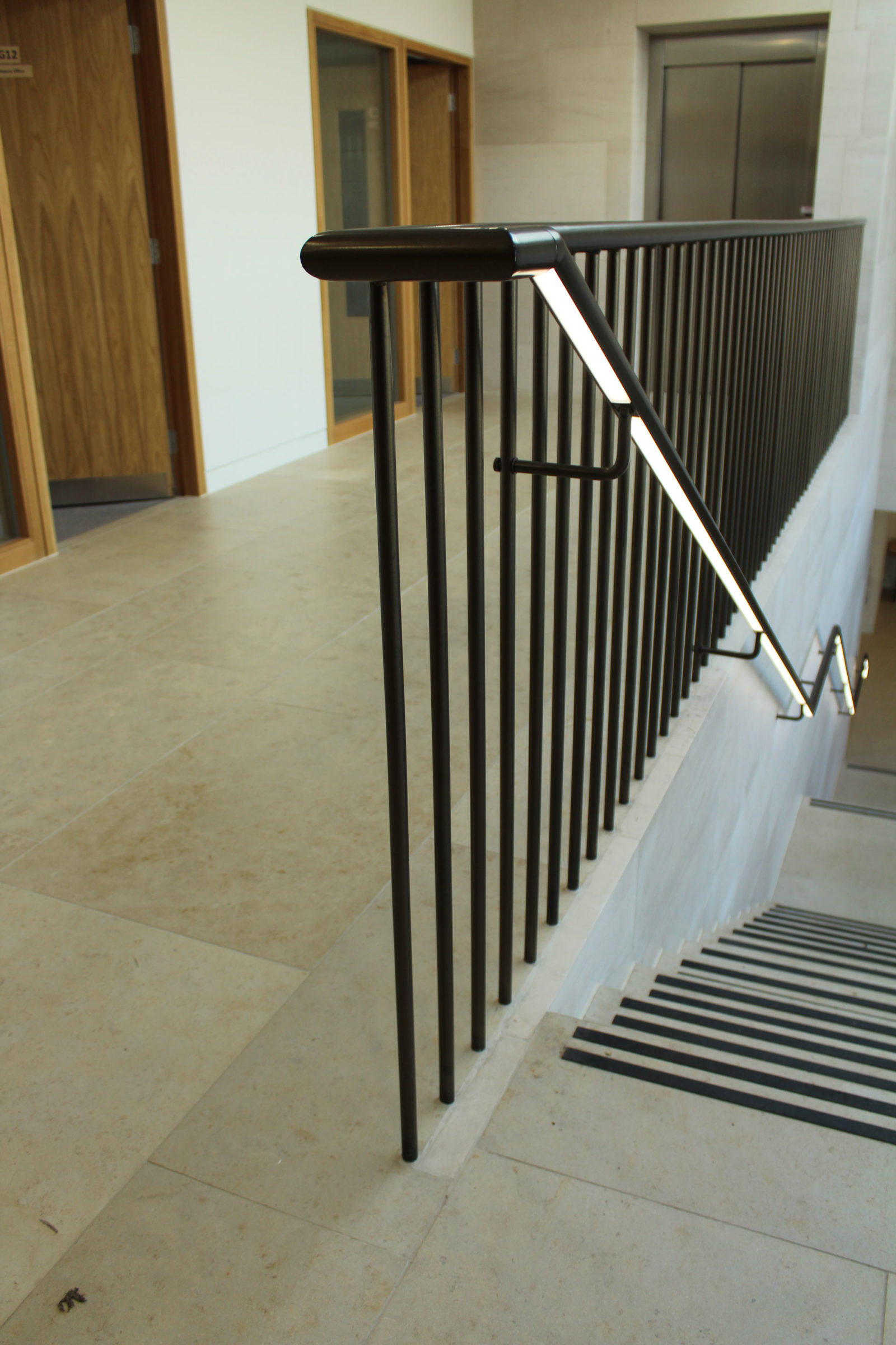 Private school lighting | Illuminated handrail Glowrail | The Light Lab