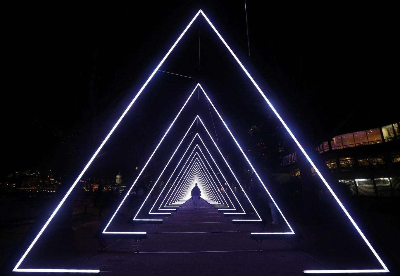 Pyramids of light over a walkway